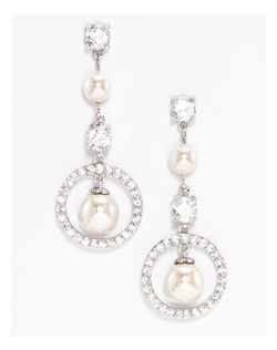 "Classic modern style with pave' and oval cubic zirconia stones alternating with freshwater pearls. Perfect for that modern contemporary bride or her bridesmaids. Length 1.75"" Width .65"""
