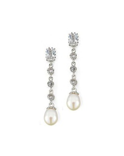 "A trail of cubic zironia ends with a creamy white freshwater pearl for a beautiful mix of sparkle and luster. Each earring measures 1.25"" long."