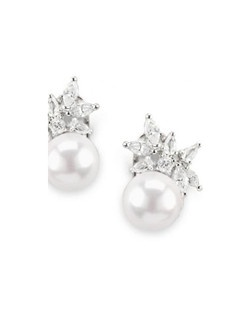 A playful pairing of cubic zirconia and pearls. Each earring drops just slightly from the ear for a very delicate look.