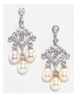"A dainty and petite chandelier earring. Ornate scallops with pave' encrusted crystals and three 6mm freshwater pearls dangle. Rhodium silver plating.  Length 1.25"" Width .65"""