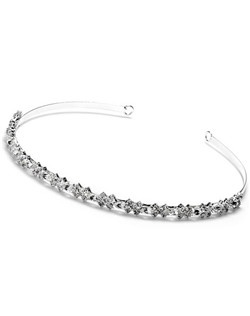 This headband is made with rhinestone ovals embedded between crystal crosses and mounted on a silver-plated headband.