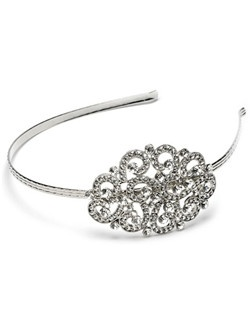 A beautiful rhodium plated headband featuring sparkling Swarovski Crystal Rhinestones set in an elegant scrolling pattern.
