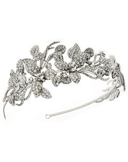 Scrolling vines, leaves, and petals encrusted with strikingly clear round cut rhinestones work their way across the band.