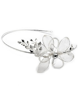 This elegant flower headband is silver plated with a stunning side accent that features rhinestones and silver mesh detailing