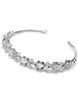This silver plated headband features a beautiful row of large glistening Swarovski Crystals and sparkling rhinestones, in an elegant design.