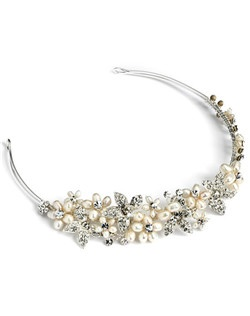 Set in a floral pattern, large opalescent freshwater pearls have been hand-wrapped along with pavé flowers in a silver tone setting and individual round cut rhinestones.