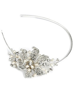 Natural genuine freshwater pearls in a soft white color are paired with clear rhinestones in an asymmetrical bridal headband.