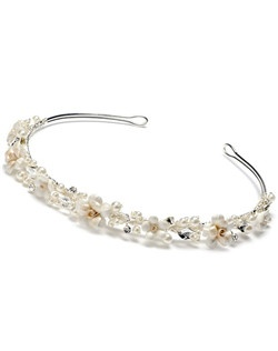 It is a pretty porcelain floral headpiece adorned with sparkling rhinestone and pearl accents.