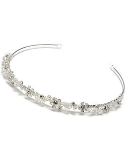 April Pearl Wedding Headband is a  delicate row of white enameled flowers, accented with tiny pearls, crystal beads, and Austrian crystal rhinestones and hand wired along the silver-tone band.