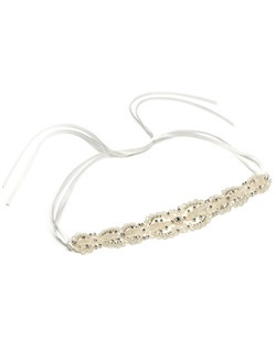 This ribbon headband has pearls in abundance, set on lovely rich satin and is accentuated with delicate silver seed beads and sparkling round cut rhinestones.