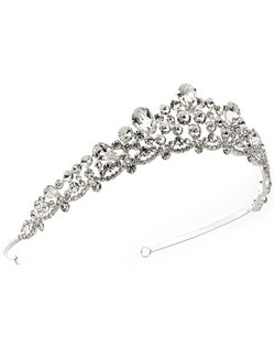 Our Kensington Bridal Crown is a rhinestone tiara designed with four sizes of perfectly cut clear rhinestones are accented by three sizes of teardrop stones.