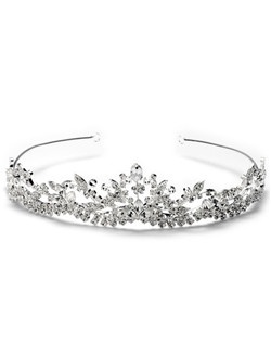 This tiara features a floral and vine design that is adorned with rhinestones along the intricate detailing.