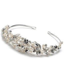 Carmella Pearl Tiara is an ivory pearl tiara headband that features sparkling rhinestones, Swarovski crystals, freshwater and large lustrous faux pearls.