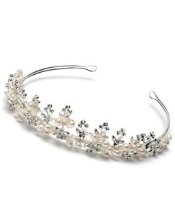 Lustrous fresh water pearls and glamorous rhinestones are encrusted within this beautiful floral and leaf design tiara crown.