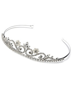 This delicate tiara is made with genuine Austrian Rhinestones and accented with two faux pearl flower designs.
