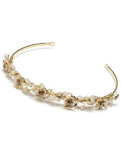 Flowers and leaves are entwined along a gold-tone headband and the leaves are embellished with amber-colored Austrian crystals and soft, matte gold enamel.