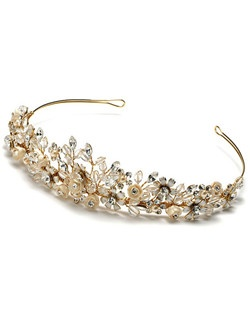 Champagne Blossom Tiara is hand-crafted with champagne rose embellishments and accented with rhinestones and crystals in a lovely floral pattern.