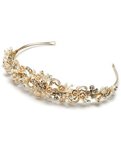 This tiara features a stunning display of champagne porcelain flowers, freshwater pearls, sparkling rhinestones, and gold plated swirl details.