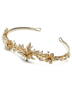 The Floral Melody Champagne Tiara is designed with white faux pearls, genuine Austrian rhinestones, and eye-catching champagne colored stones.