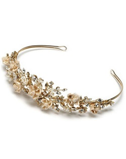 features  gold plating, clusters of creamy freshwater pearls, handcrafted porcelain flowers, and sparkling rhinestones.