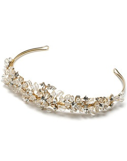 A hand-made tiara made with a mixture of crystal beading, Genuine Swarovski Crystals and sparkling rhinestones.