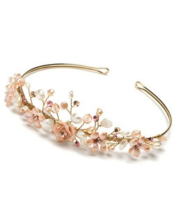 Rose Garden Bridal Tiara showcases pink ceramic roses, Keshi Pearls, hand-cut pink Genuine Swarovski Crystals and Rhinestones, as well as and Freshwater pearls.""