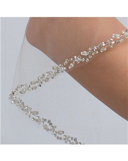 Features a delicately scattered pattern of alternating pearls, rhinestones, bugle beads and tiny sequins.
