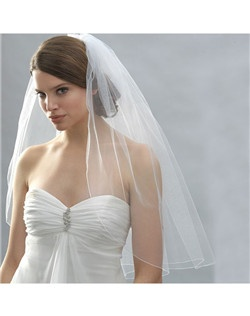 This veil has a thin finished or hemmed edge that gives definition and a slight outline to the bridal veil.