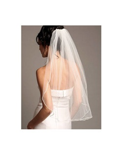 This elegant bridal veil has an satin cord that beautifully outlines the edge of the veil.