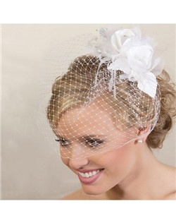 Double Rose Cage Veil features two beautiful rose flowers made with silk and tulle netting and highlighted with a pearl and rhinestone center.