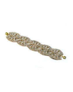 Have a heart of gold with this statement gold applique cuff. Double strand rhinestone chain in linked oval swirls make this a perfect addition to your formal attire and again for a night out!