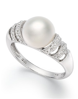 Simple elegance. This sterling silver ring highlights a cultured freshwater pearl (9mm) with diamond accents at the sides and a pretty cut-out design in the band. Size 7.