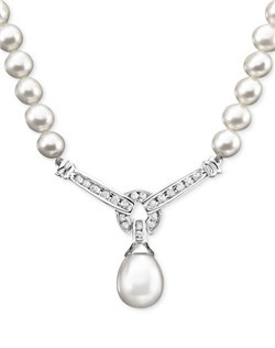 Elegant pearls (9mm) are heightened in beauty with the addition of sparkling round-cut diamonds (1/3 ct. t.w.) in this breathtaking necklace. Approximate length: 17 inches. Approximate drop: 1-1/4 inches.