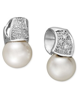 Say hello to elegance. Belle de Mer stud earrings feature a luxurious mix of cultured freshwater pearls (9mm) and sparkling, round-cut diamonds (1/5 ct. t.w.) in a 14k white gold wave setting. Approximate drop: 3/8 inch.