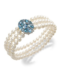 Cool elegance. Cultured freshwater pearls (5-7-1/2mm) combine with round oval pear and marquise cut shades of blue topaz (4-1/6 ct. t.w.) for a look that's refined and sophisticated. Set in sterling silver. Approximate length: 8 inches.