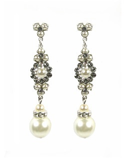These delicate and feminine pearl earrings compliment many gown styles exquisitely. Swarovski crystals and pearls come together in a perfect marriage to create a classic yet stylish bridal earring. Pearls are beautiful ivory and white combination to match all fabrics.