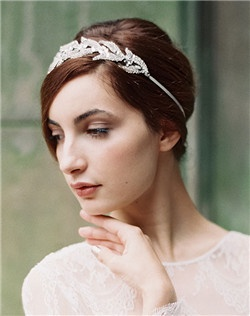 Looking for Lady Mary's Downton Abbey look? Enchanted Atelier does it beautifully with this Swarovski crystal leave and delicate floral crown headband. As seen on Brides.com. Available on a ivory ribbon closure (shown) or metal frame.