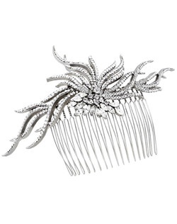 A stunning comb in the shape of a crystal starburst. Can be worn in the back or the side. A dramatic accent for any wedding hairstyle. Bejeweled with Swarovski crystals. Designed in NYC by Regina B.                                                                                Length: 5 3/4"