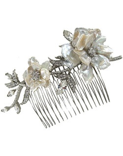 Classic elegance defined. This romantic hair comb uses freshwater pearls and crystal vines to add a glittering touch of nature to your special day. Bejeweled with Swarovski crystals. Designed in New York by Regina B.                                       Length: 5 1/4"