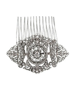 Classic elegance in the form of a glittering bridal comb. Comprised of Swarovski encrusted swirls surrounding a crystal center. If you are looking to add a vintage touch then this is a perfect bridal hair accessory for you. Designed in New York by Regina B.                                                                                       Length: 3 1/4"