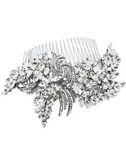 Choose this glittering bridal hair comb to make a statement on your wedding day. An artistic combination of different shaped Swarovski crystals make this comb a beautiful accent to any hairstyle. Designed in New York by Regina B.                                                                                                                               Length:5 1/2"