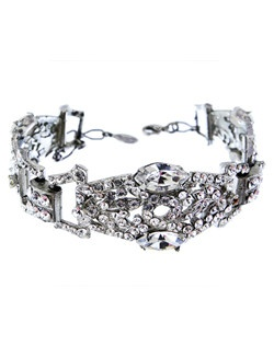 Choose this glittering bridal bracelet to add a touch of classic elegance to your wrist. A stylized swirl pattern encrusted with Swarovski crystals. Designed in New York by Regina B.                                                                                                                                      Length: 5"