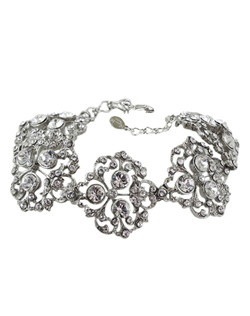 This charming Victorian inspired bracelet is formed in light and airy design. Delicate filigree pattern, accented with few large round Swarovski crystals. Designed in New York by Regina B.                                                                                                                          Length: 6"
