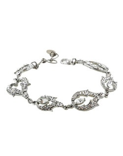 A delicate Swarovski crystal bracelet that is ideal to add a touch of glitz to any wrist. Designed in New York by Regina B.                                                                                          Length of design: 5 3/4"