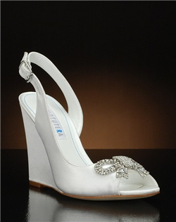 Peep toe slingback wedge with crystal bow embellishment