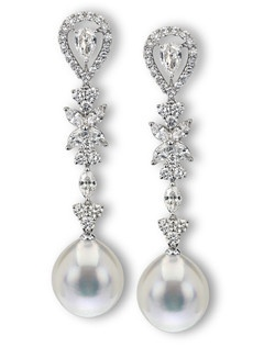 This extraordinary pair of drop earrings features a gorgeous pair of 13.5mm South Sea pearls as well as 3.55ctw of round and marquis diamonds.