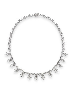 Just like Greta Garbo, when you wear this Winston-like cluster necklace, you will be an image to behold. This necklace has 15.87ctw of diamonds set in 18K white gold.