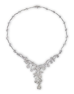 This dramatic diamond necklace would look stunning with a sweatheart neckline. Named for fame actress Mary Pickford, this one-of-a-kind necklace contains 10.9ctw of diamonds set in 18K white gold.