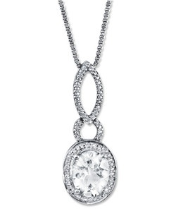 The captivating oval lab-created white sapphire is certain to turn heads in this alluring necklace for her. Accented with diamonds and crafted in sterling silver, the pendant suspends from an 18-inch box chain that fastens with a lobster clasp.