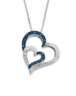 A heart nestles against a larger heart in this romantic necklace for her, adorned in round white diamonds and Artistry Blue Diamonds™. The sterling silver pendant sways from an 18-inch box chain secured with a lobster clasp. The necklace has a total diamond weight of 1/20 carat. Artistry Blue Diamonds™ are treated to permanently create the intense blue color.